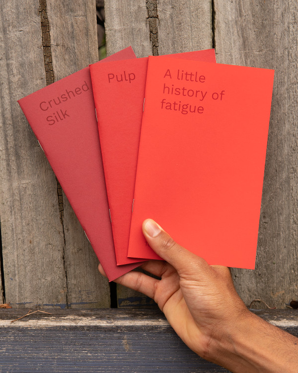 Red Series - image of three pamphlets, each a different shade of red